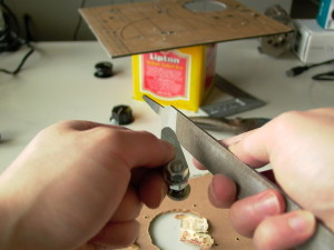 Filing the contacts to shape.